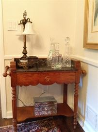 Vintage heart pine dry sink, with black veiny marble top and backsplash - nicely turned spindle legs and double side handles.                                                                                         Nice collection of cut crystal decanters for all those impromptu neighborhood gatherings - you know that lush that lives next door...
