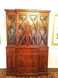 "Beautiful vintage 1940's flame mahogany breakfront china cabinet, with ""bubble"" glass doors and a drop-front desk section with leather writing surface."