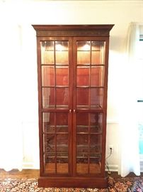 Nice lighted curio cabinet, with five adjustable glass shelves.