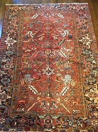 "Vintage hand woven Persian Heriz rung, 100% wool face, measures 5' 9"" x 7' 9""."