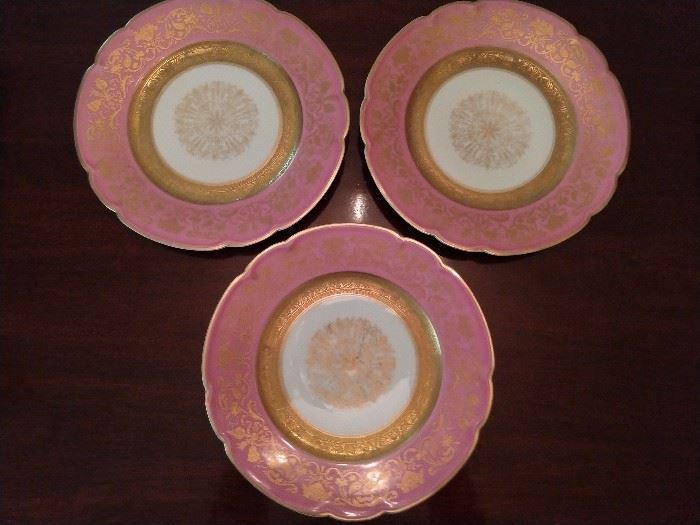 "There is a set of eight of these pink rim, w/gold filigree & scalloped edge, 10"" Black Knight dinner plates; three pictured for detail.                                                                                                       The Black Knight mark was used between about 1925 and 1941 - Graham & Zenger was a New York City based importer and wholesaler. The blanks were originally manufactured then designed and painted by the Hutschenreuther Porcelain Factories to be imported.     It is believed in the late 1930's, the company transferred their decorating company to the US while still buying their blanks from Germany. At the outbreak of WWII, Graham and Zenger and their Black Knight China brand ceased trading."