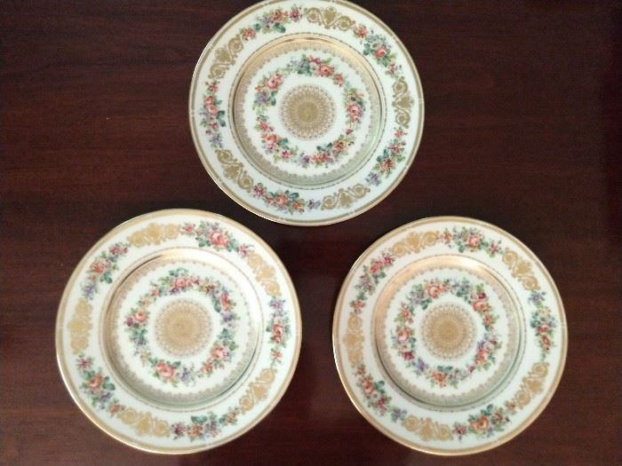 "There is a set of eight of these  9 3/4"" hand decorated dinner plates ""Chateau De Neuilly""; three pictured."