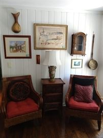 Nice pair of rattan armchairs, with matching side table. Original, artist signed artwork on wall.