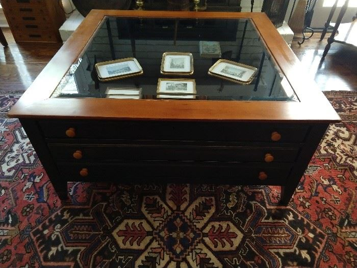 Three drawer coffee table, with beveled glass top, to display family treasures in the top drawer and all the remotes and medicinal herbs in the two lower drawers.