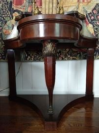 Close-up detail of the French mahogany curved front entry table leg.