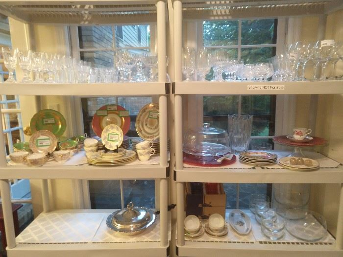 Not a good close-up, but your looking at very good Baccarat stemware, along with some smaller sets of good china.
