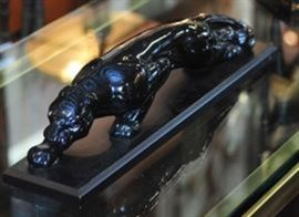 Black Enamel Jaguar on a Wood Base.