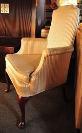 Cream and Gold Armed Wing Chair.