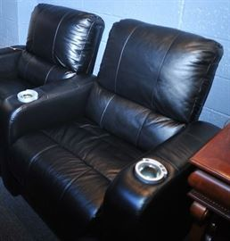 Three Leather Reclining Theatre Chairs.