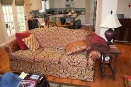 Three cushion sofa upholstered in red and gold medallion print