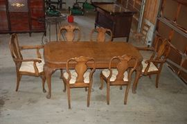 Exquisite burled maple dining room table with 6 chairs
