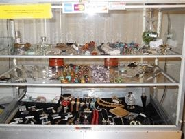 Showcase filled with jewelry, Waterford ornament w/stand & box, Perfume, watches, etc.