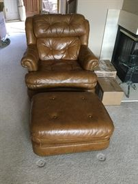$150   Brown leather chair with footstool