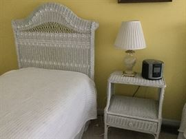 $20  White wicker bedside table