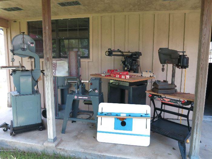 Delta Band Saw, Shop Smith Dust Collector, Shop Smith Belt Sander+ Power Station, Craftsman Radial 100, Craftsman Drill Press, Black & Decker Work Bench