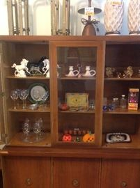Eclectic mix in display cabinet.
