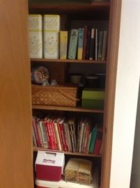 Cookbooks $1 each. Coolers, picnic basket, tin canisters.