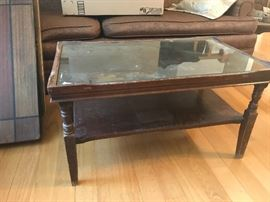 Glass top coffee table with shelf.