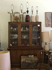MCM Display Cabinet and lamps (lamps on top right and side right SOLD). Child's rocker. MCM end tables. Artwork. Accessories.