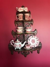 Beautiful antique carved rosewood wall etagere. Also pictured are just a few pieces of red and white transferware from England.