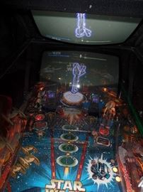 Star Wars pin ball machine.  When certain bumpers are hit a hologram will appear   (better pictures soon)  buy it now: $6,500.