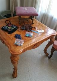 contemporary side table...purses and pouche...magic stones...needlepoint footstool