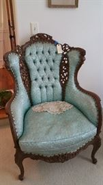 amazing upholstered arm chair in a lovely pale turquoise, very unusual but is the color of the day....and....wait for it...