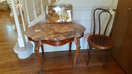 very wonderful entry or center table with gray and rose marble top, marquetry around the sides and figural ormolu....bent wood chair