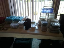 Numerous containers of crafting beads.