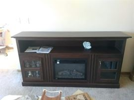 Napoleon Fireplace and cabinet - Cherry Mocha.  Purchased 6/2017.