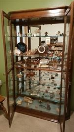 This is one beautiful Curio Cabinet with Glass Shelves and Mirror Back. Wonderful.