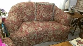 Rust/Red Floral Love Seat by LaZBoy England.  Side Table.