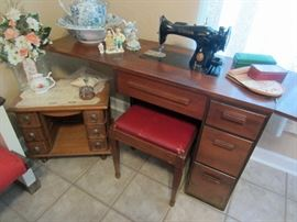 Vintage sewing machine with cabinet and note the converted sewing machine cabinet on wheels.