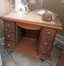 Sewing machine cabinet converted to storage on wheels