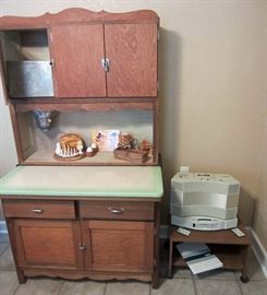 Reworked Hoosier cabinet with original sifter and porcelain top.  Vintage Bose radio, cassette player, and CD player  (Hoosier cabinet pulled from sale by heir)