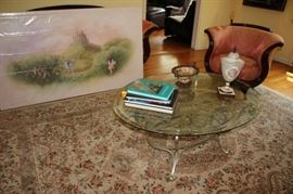 Art and Round Metal & Glass Coffee Table with Handmade Rug, Decorative Items and Books