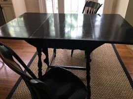 Antique Black Mahogany Drop Leaf Table with three matching Chairs