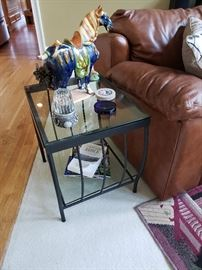 Pair of wrought iron end tables with glass tops