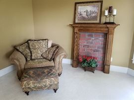 Oversized chair and ottoman by Alan White; mantle and faux fireplace