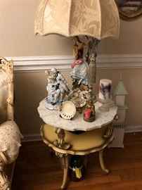 Vintage Italian Marble top table (there is a pair).  Italian Lamp with Parasol Lamp shade.  Lamp has a companion