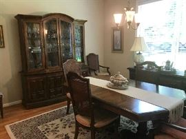 Dining set, 6 cane back chairs, table w/extra leaf , china cabinet, and server