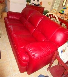 Made by Palliser:  red leather sectional with large matching ottoman and lounge chair from Canada