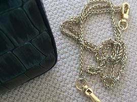 """*NEW* ROBERTO CAVALLI EMBOSSED LEATHER CLUTCH: Forest green. Comes with gold chain for shoulder strap and detachable wrist band. Dimensions: Width: 8"""". Height: 4""""."""