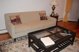 Sofa, Accent Pillows, Coffee Table and Rug with Small Round Side Table and Lamp