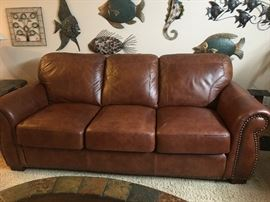 Leather couch and love seat that look brand new.