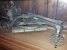 Rare Salesman Sample of Adams Leaning Wheel Grader by J.D. Adams & Co. Road Building Machinery  housed in a custom-made wood & glass display case, and includes Adams Mfg. Co original salesman's travel case with tag used for this road grader.