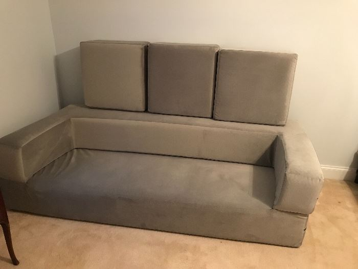 Origami futon. Can be set up as a twin bed as shown previously. Laid out as a king bed. Or made into a couch as shown here.