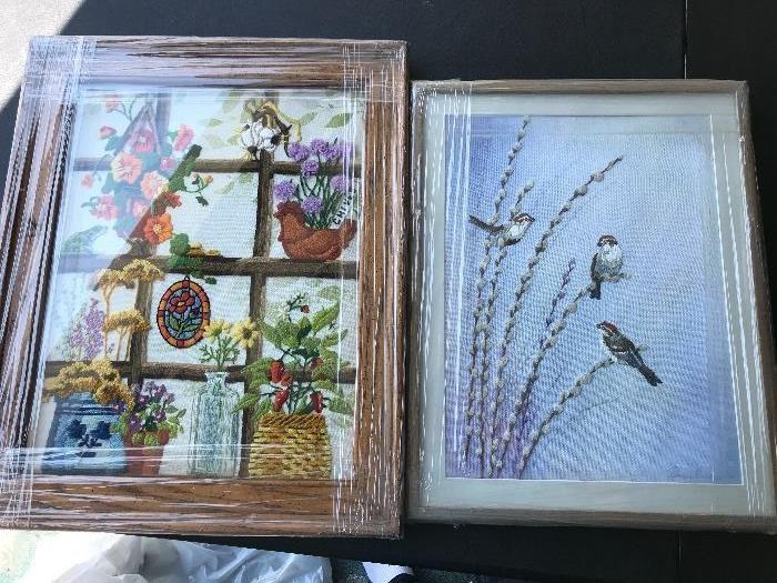 Handmade needle point art with frames.