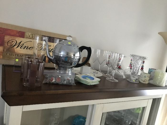 Various household decorations, crystal, glasses and other serving items. The curio cabinet is also for sale.