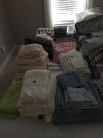 Various linens. Towels, curtains, bedding, table cloths, placemats etc.